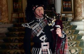 A Scottish bagpipe player