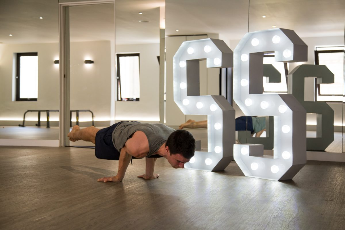 A trainer practicing yoga in Sweat Society