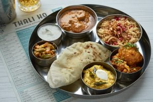 Thali-style dining involves a platter filled with several small dishes. Photo: Shamim and Shah Malek