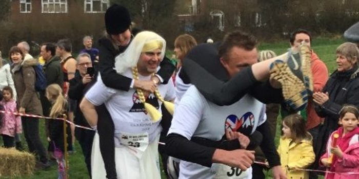 Record numbers compete in the UK Wife Carrying Race in Dorking